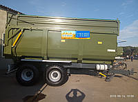 Тракторный самосвальный прицеп ТСП -20 с трехсторонней разгрузкой грузоподъемность 16т, объем 19-26 м3, фото 1