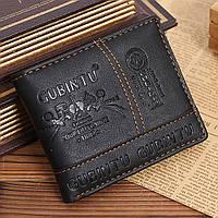 Мужской кошелёк чёрногоцвета с тиснением черный портмоне