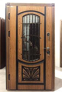 Входная дверь с ковкой