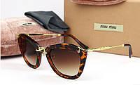 Солнцезащитные очки Miu Miu (smu10n) leo