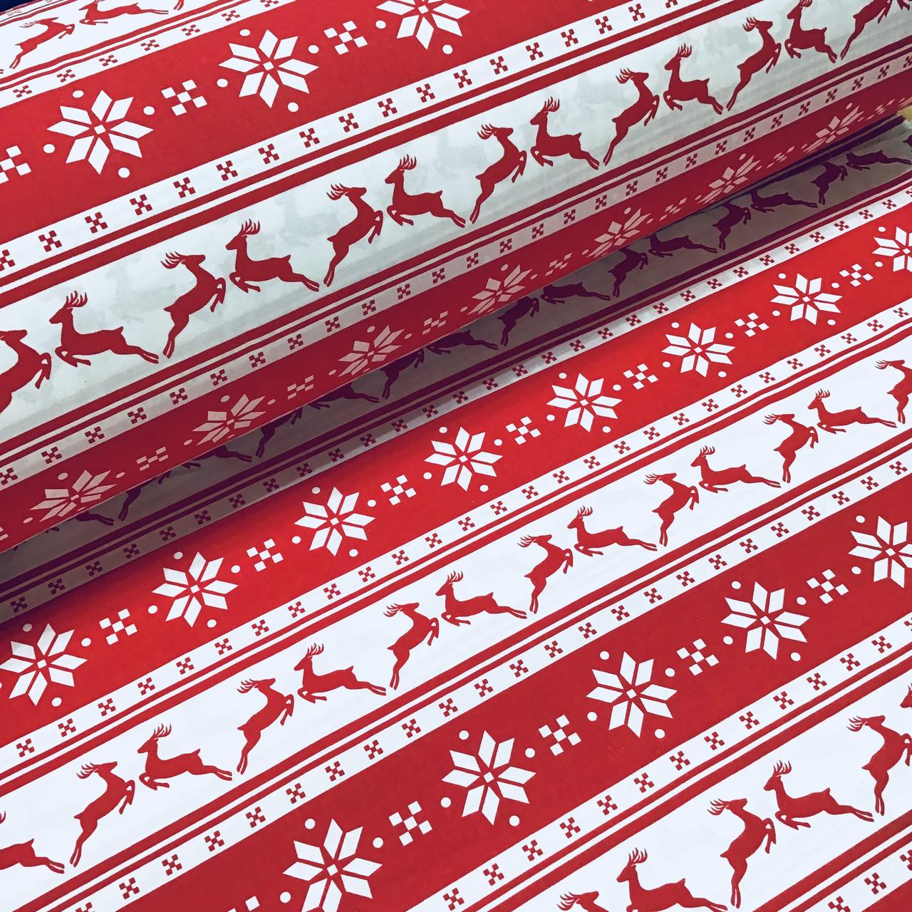 Тканина бавовняна новорічна, олені і сніжинки на червоній і білій смужці