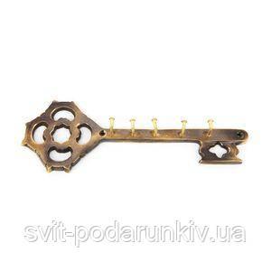 Вешалка для одежды в виде ключа - фото