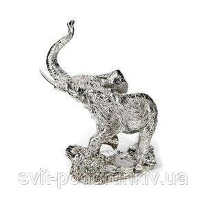 Фигурка слона с поднятым хоботом - фото