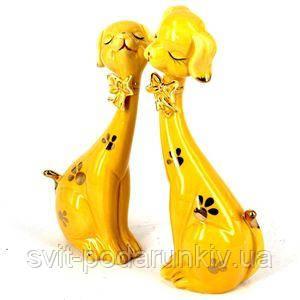 Статуэтки желтых собак - фото