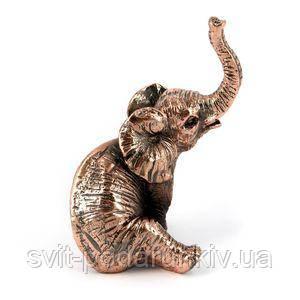 Фигурка сидящего слона - фото