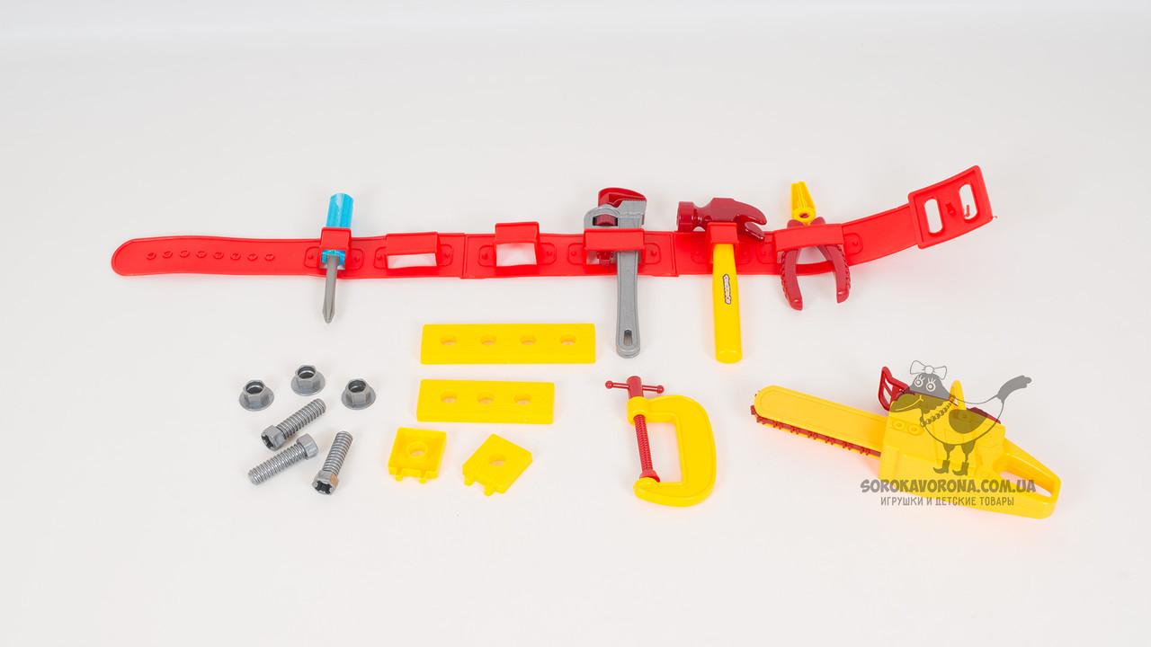 Игровой набор инструментов на пояс. В комплекте - плоскогубцы: пила: молоток: отвертка: болты