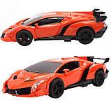 Іграшка машинка трансформер робот на пульті управління автобот orange, фото 2