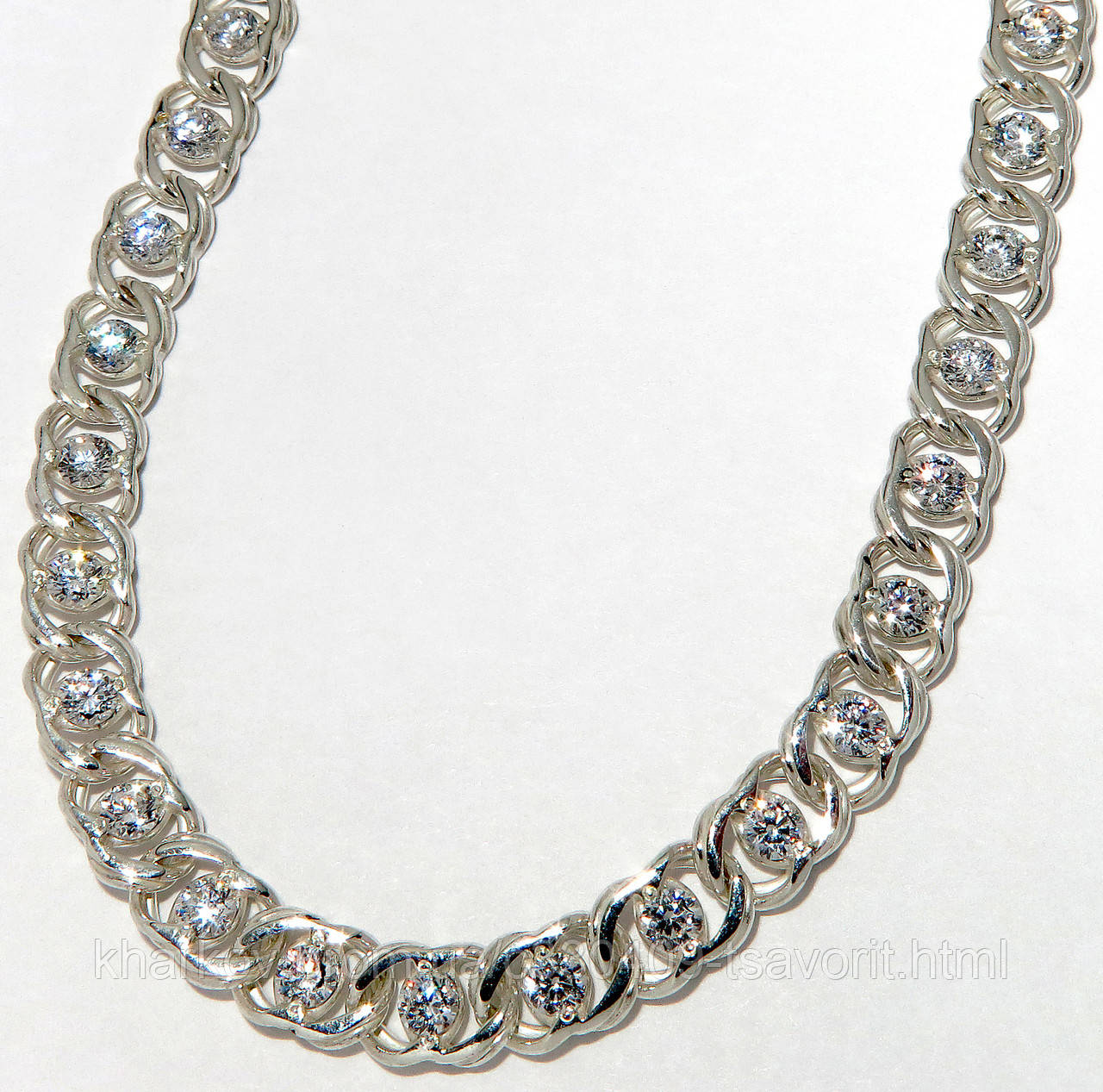 Серебряная цепочка с камнями