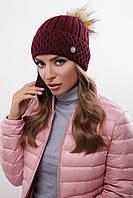 Стильная теплая женская вязаная шапка с меховым бубоном цвет марсала
