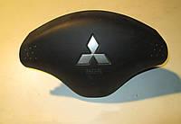 Подушка безопасности водителя Airbag Mitsubishi L200, 2005-2014 г.в. MR992559XA