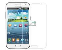 Защитное стекло Samsung i8552 Galaxy Win (0.3 мм, 2.5D, с олеофобным покрытием) Самсунг