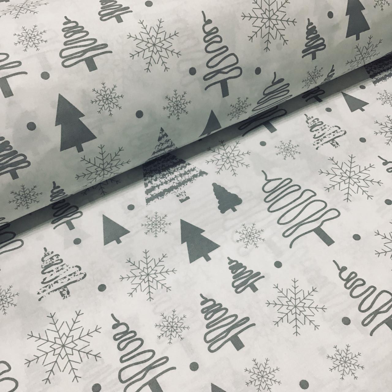 Ткань новогодняя хлопковая, серые елочки и снежинки на белом