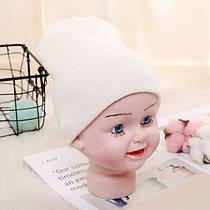 Детская вязанная демисезонная шапка молочный