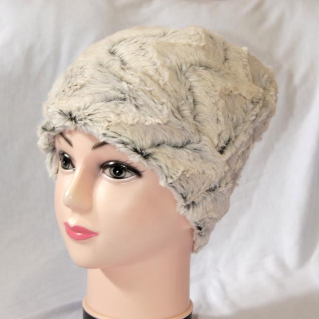 Меховая шапка женская
