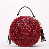 Женская круглая сумка кросс-боди кожаная с кисточкой и длинным плечевым ремешком красная, фото 1