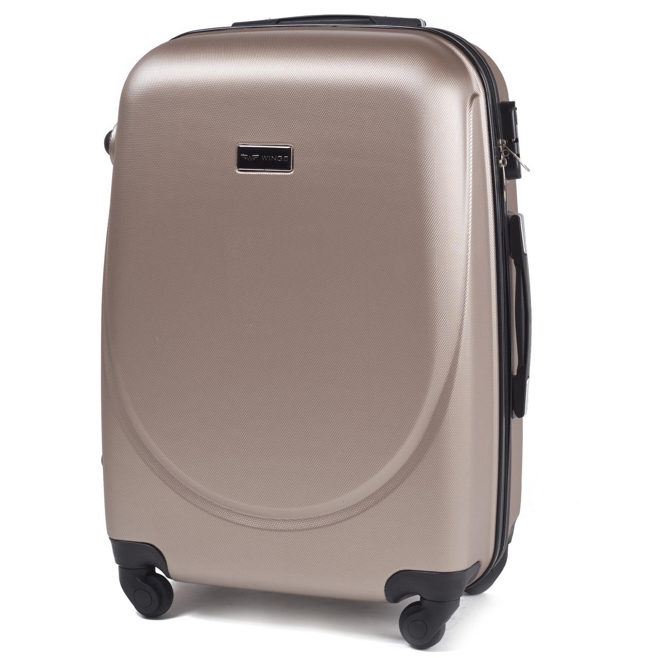 Малый пластиковый чемодан Wings 310 на 4 колесах золотистый