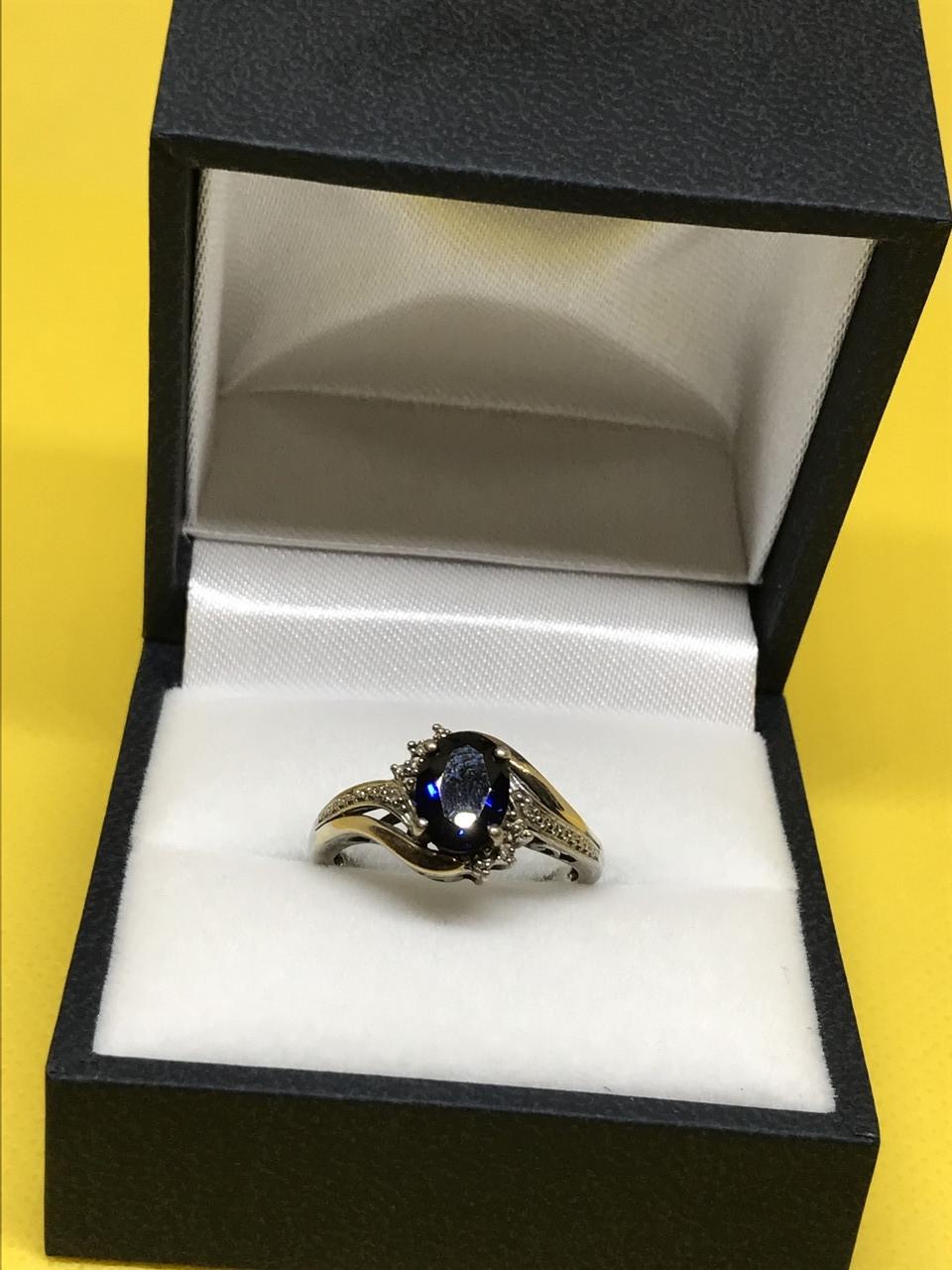 Серебряное кольцо с золотыми вставками с синим топазом