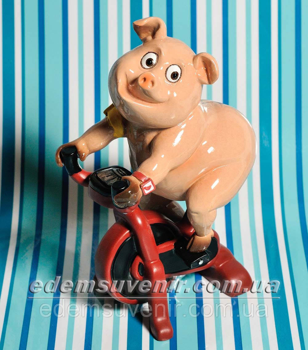 Статуэтка декоративная Свинка на велотренажере
