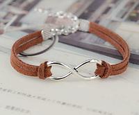Кожаный браслет с серебристым кулоном Бесконечность, цвет - коричневый
