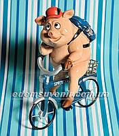 Статуэтка декоративная Свинка на велосипеде