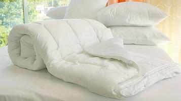 Одеяла, подушки, наматрасники.