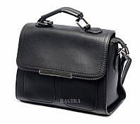 Женская сумка-клатч из кожзаменителя с накладными кармашками