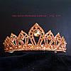 Корона под красное золото с золотистыми камнями, высота 4 см.