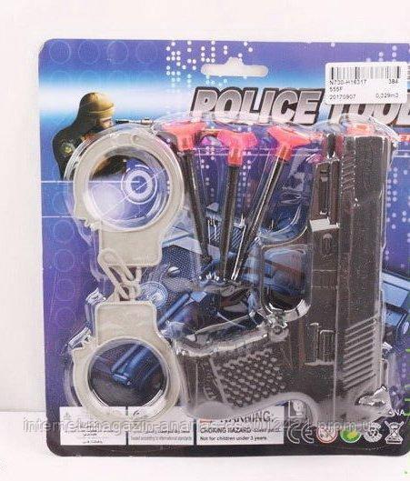 Полицейский набор: пистолет, наручники, присоски, на планшетке