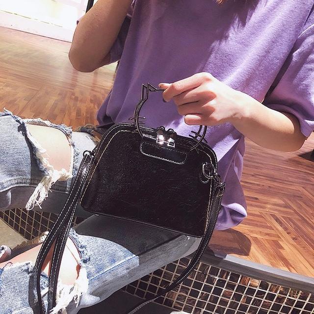 Блестящая мини сумочка в черном цвете