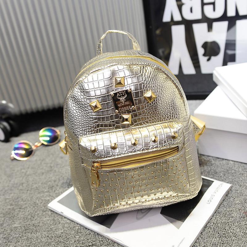 Жіночий рюкзак маленький золотистий з заклепками екошкіра