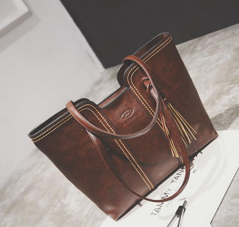 Женская сумка большая коричневая с кисточкой из качественной экокожи опт