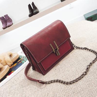 Женская сумочка маленькая бордовая через плечо на металлической защелке