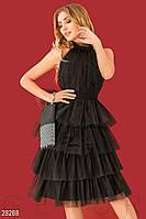 Вечернее черное платье с открытой спиной и пышной юбкой
