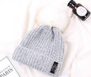 Женская зимняя шапка серая с белым помпоном