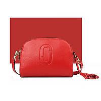 Маленькая кожаная красная сумка через плечо с кисточкой