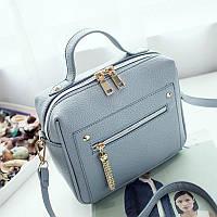Женская сумочка голубая с молниями