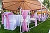 Розовые банты или шлейфы на стулья