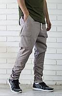 Бежевые брюки джоггеры с карманами карго