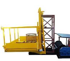 Строительный подъемник-подъёмники мачтовый секционный  г/п-1000 кг. с выкатным лотком. Высота подъёма, м 65, фото 3