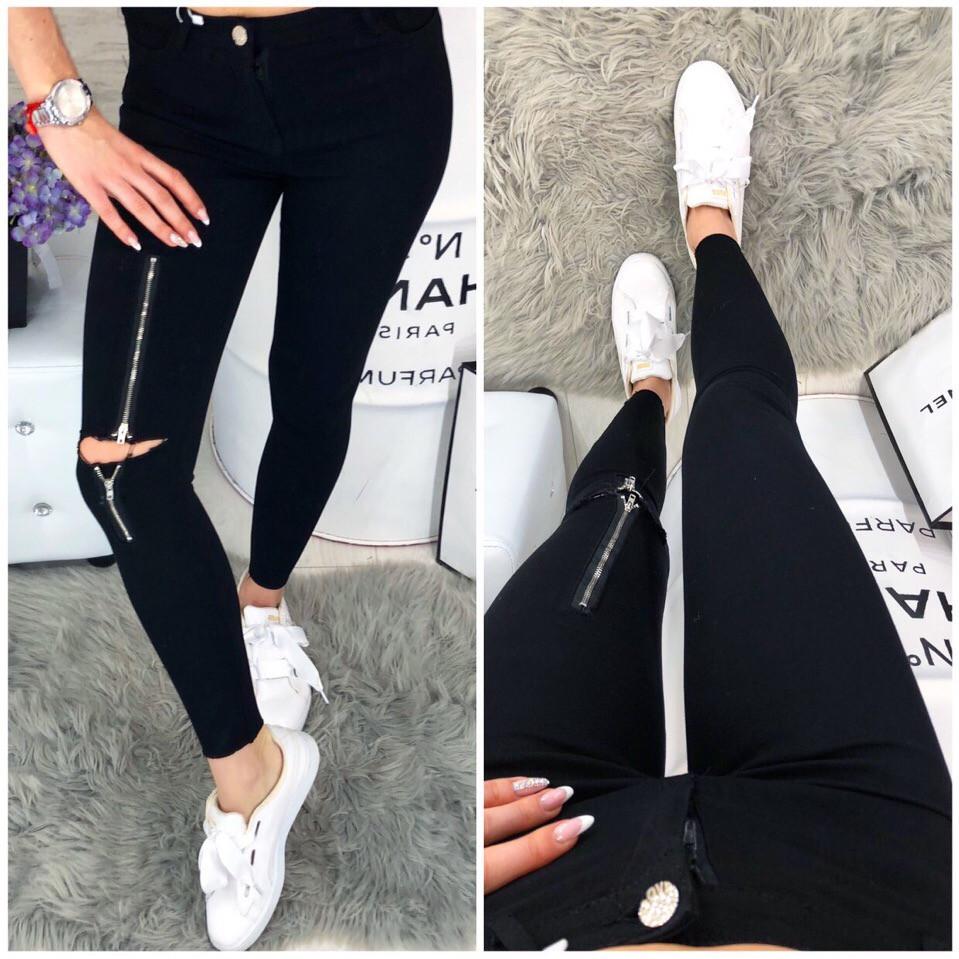 Черные джинсы с серебристой молнией