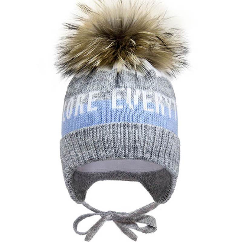 Зимняя шапка с натуральным бубоном (енот)  р-ры 46,48