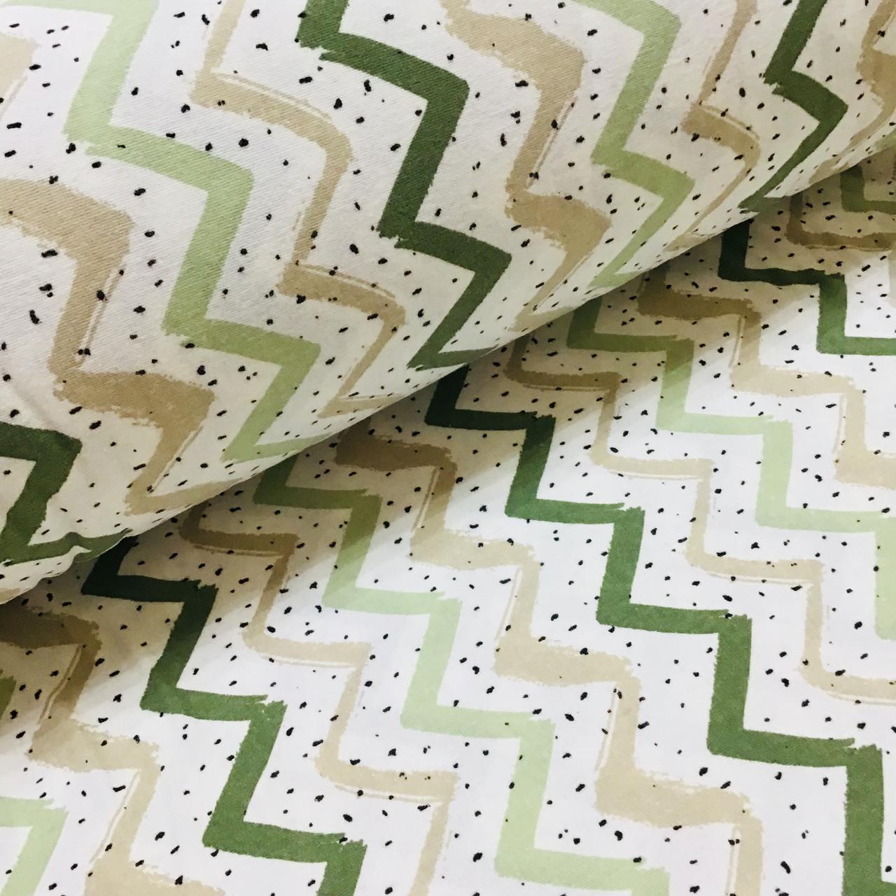 Фланелева тканина зигзаг коричнево-зелений з чорними цятками на білому (W,шир. 2,4 м)