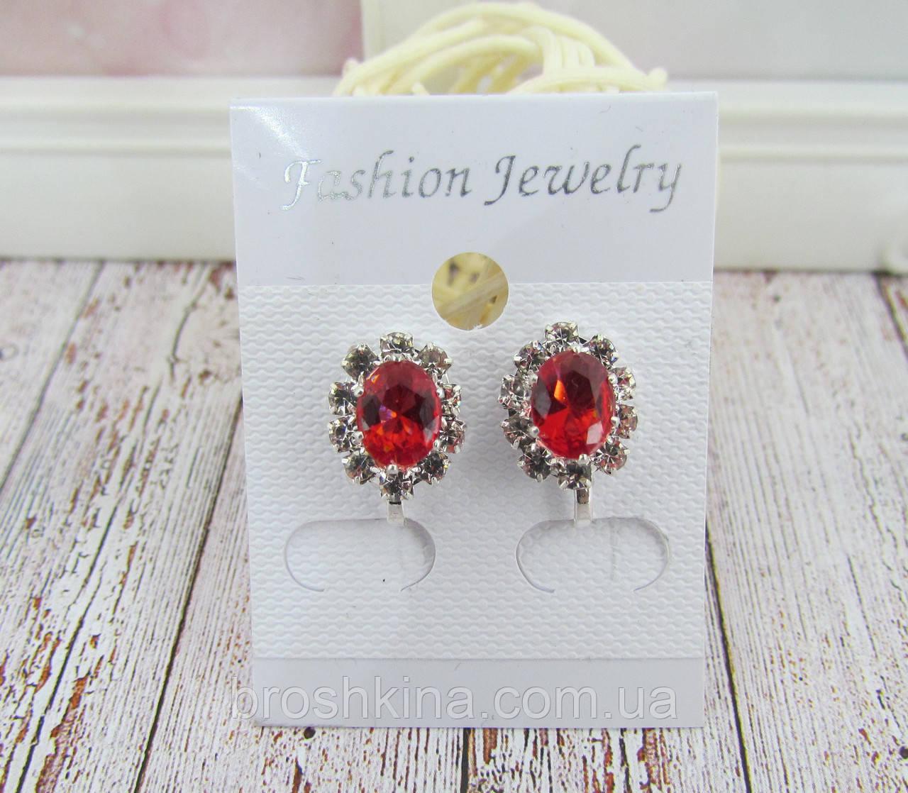 Клипсы овальные с красными кристаллами 1,3 * 1 см