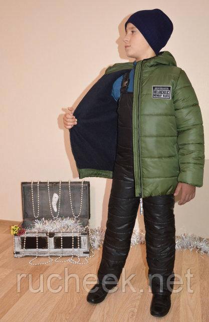 Купить зимнюю курткупуховик  для мальчика 7-9 лет