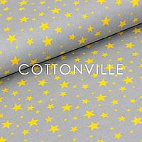 Хлопковая ткань Звездная россыпь желтая на сером