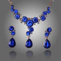 Набор бижутерии с синими камнями колье, серьги