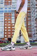 Спортивные мужские трикотажные штаны желтые Cage