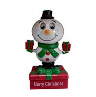 "Сувенир ""Танцующий Снеговик с подарками"" на солнечной батарее (12-1)"