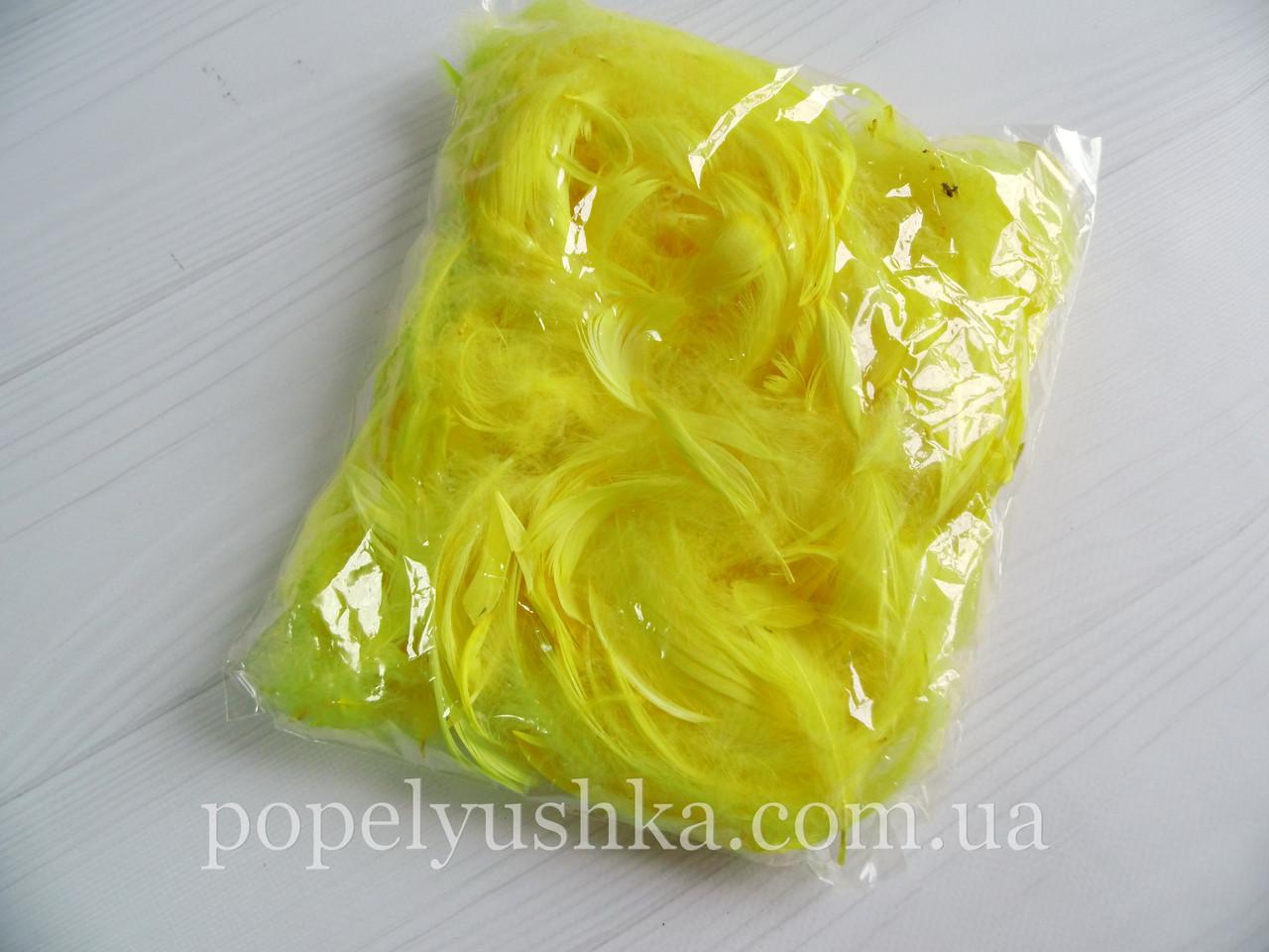 Пір'я жовте упаковка