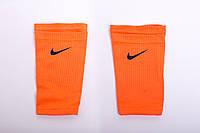 Держатели для щитков Nike 1070 чулки найк оранжевые